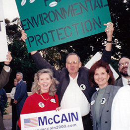 REP co-founder Aurie Kryzuda (r) and other California members at a McCain rally in 2000.