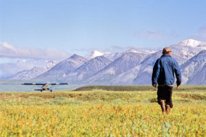 Guide walks across the tundra toward a