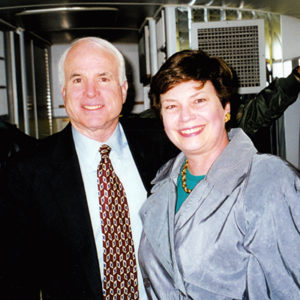 REP President Martha Marks rides with Senator John McCain on his