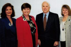 REP leaders Aurie Kryzuda, Martha Marks, and Kathy Roediger pose with Senator John McCain in January 2000.
