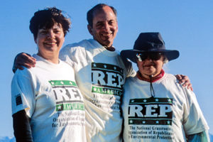 Martha, Jim, and Fran wear their REP t-shirts for a photo on the tundra.