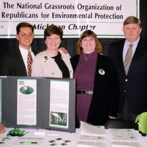 Early members of the Michigan Chapter table for REP, with Martha Marks